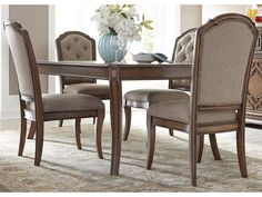 """This five piece rectangular table set will give your dining room a traditional and casually elegant atmosphere.  Each piece is crafted from birch solids and birch veneers in an antique toffee finish for that classic appearance.  The table includes a single 16"""" leaf to extend the surface from 74"""" to 90"""".  The corresponding upholstered side chairs feature a comfortable brown tweed, along with tufted backs.  Additional design elements include the saber shaped legs and antique brass nailheads."""