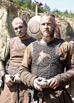 Vikings-Floki and Ragnar. Note the raven on Ragnar's shirt.