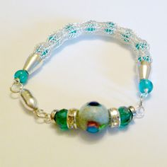 Ladies Viking knit bracelet Hawaii inspired silver by DonnaDStore, $26.99 and featured here http://www.etsy.com/treasury/MTgwMDY0MTN8MjcyMjcxNDMzNA/sunny-springtime-saturday
