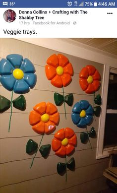 Painted plastic veggie trays (flower and leaf, razor knife to cut) someone suggested instead of grass skirt string for stem use garden hose. Fun Summer Activities, Painting Plastic, Plastic Trays, Veggie Tray, Plastic Flowers, Garden Art, Garden Hose, Recycling, Projects To Try
