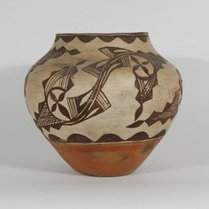 "#adobegallery - Zia Polychrome Jar with Capped Spirals, circa 1900. Potter Unknown      Category: Historic     Origin: Zia Pueblo     Medium: Native Materials     Size: 10-3/4"" tall x 12"" diameter     Item # 25233"