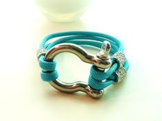 Simple & Stylish: A new twist on a paracord project. It is even made in my favorite color!  https://www.paracordplanet.com/550-Type-III-7-Strand-Mil-Spec-Commercial-Grade-Turquoise-Paracord_p_584.html