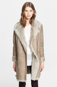 Free shipping and returns on Vince Asymmetrical Genuine Shearling Coat at Nordstrom.com. Crackling Toscana lambskin leather with gorgeous shearling fur trim accentuates a box-cut jacket stylized with an asymmetrical placket and roomy front welt pockets.
