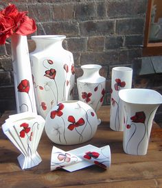 Hand painted fine bone china in the Poppies design. All unique one off pieces and signed by Emma Bailey.