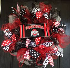 Ohio State Buckeyes inspired deco mesh wreath, Ohio State mesh wreath, front door wreath, sports wreath  by ShellysChicDesigns on Etsy https://www.etsy.com/listing/200219215/ohio-state-buckeyes-inspired-deco-mesh