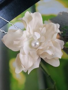 Pair of small ivory flowers with pearl or crystal center by One World Designs Bridal Jewelry