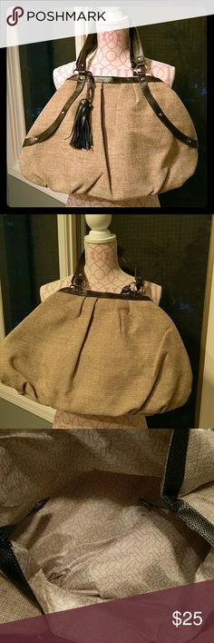 NEW tote NWOT never used extra large tote great for overnight, beach, or to carry things to the office. Very lightweight. Make of cloth, lined on the inside with snap closure. 21X13 Boutique Bags Totes