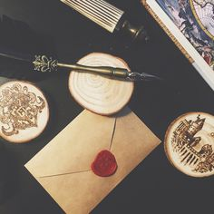 A photo of my workshop table working on some Hogwarts themed ornaments and coasters! Follow me on Instagram or Etsy at KKYCC to keep up with updates!  www.etsy.com/shop/kkycc www.instagram.com/kkycc