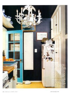 This iconic kitchen by Ruthie Sommers from Domino has been pinned and posted about countless times. If you'd like to copy this look yourself, the walls are a VERY dark navy blue by Benjamin Moore called Soot 2129-20. The door is Benjamin Moore Poolside Blue 2048-40. Add a vintage chandelier spray painted white and some blue and white Chinese porcelain and china.