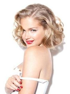 classic red lips and matching nails+ I do believe her hair is pinned to look that length...must give it a try