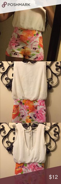 Floral and White Romper ! Super Cute Romper! Very comfortable , Never Worn! No tags Pants Jumpsuits & Rompers