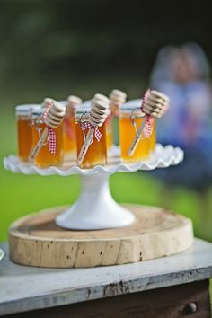 Honey for party favors- maybe I can get mini honey bears from Bron's Bees