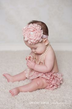Pink ruffle baby bloomer/ diaper cover and headband set that is great for photoshoot. $35.00, via Etsy.