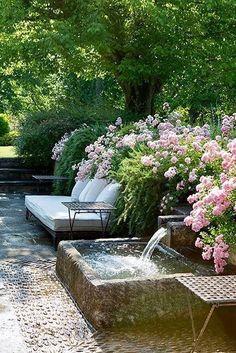 Backyard garden ideas. Lush flowers. Tranquil waterfall, perfect for a little meditation and Zen.