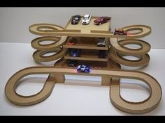 Pista de carrinho DIY Magic track with magic cars out of cardboard Cardboard Crafts Kids, Diy Crafts For Kids, Projects For Kids, Fun Crafts, Cardboard Model, Cardboard Car, Toy Garage, Homemade Toys, Diy Toys