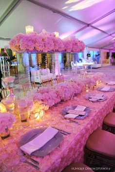 Dominique & Dawan Landry's pink and silver tablescape. Wedding and design by Tiffany Cook Events