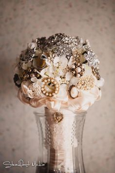 Brooch bouquet with lace from the bride's mother's dress.