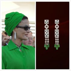 She was wearing Cartier Panthère diamond earrings~! With white gold, diamonds, onyx, emeralds.