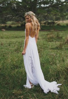 Sensual low-back Grace Loves Lace The Hollie beach/bohemian wedding dress with spaghetti straps, layered translucent skirt with side slit and delicate train. {Facebook and Instagram: The Wedding Scoop}