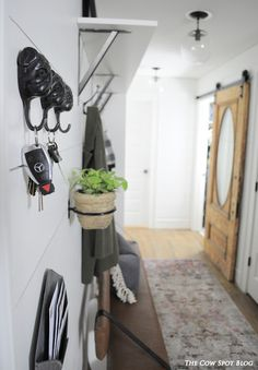 DIY Mudroom with Shiplap, antique barn door and DIY upholstered bench