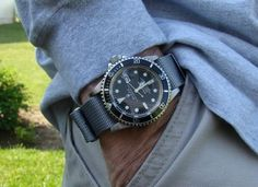 Rolex submariner with grey nato strap
