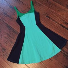 NWOT Green & Navy Color block fit and flare dress Very cute green and navy color block fit and flare dress.  This dress has never been worn only tried on once and then never got around to wearing it.  95% cotton 5% spandex Express Dresses