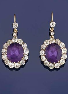 A pair of late Victorian amethyst and diamond pendent earrings Each designed as an oval amethyst and old-brilliant cut diamond cluster suspended from a single-stone diamond surmount with diamond-set connecting link, circa in a fitted case. Amethyst Quartz, Amethyst Jewelry, Amethyst Earrings, Pendant Earrings, Victorian Jewelry, Antique Jewelry, Vintage Jewelry, Jewelry Art, Fine Jewelry