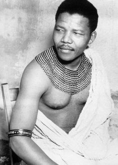 Nelson Mandela wearing an authentic beaded necklace of the Thembu clan. Source: News Limited. - Nelson Mandela belonged to the Thembu tribe, one of the main tribes of the Xhosa people of South Africa. People Of The World, My People, Nelson Mandela Pictures, Apartheid, Charles Darwin, My Black Is Beautiful, Beautiful Guys, African American History, Famous Faces