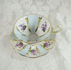 Queen Anne Bone China Teacup and Saucer- Violets, Sky Blue, Gold- Antique- Made in England- Vintage China via Etsy