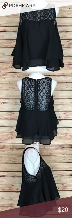 "Paper Tee Black Floral Embroidered Crop Top 1X Paper Tee crop top. Black with sheer embroidered panel. Floral. Sleeveless. High low. Crew neck. Back zip. 1X.  Excellent preowned condition with a couple of runs in the back fabric.  Measurements are approximately: 42"" bust, 52"" waist, and 23"" length.  Polyester/nylon.  No trades. All items come from a pet friendly home. Bundle to save! paper tee Tops Crop Tops"