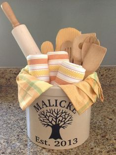 10 Gorgeous DIY Gift Basket Ideas Bridal Shower Gift: Personalized Crock from , towels and tablecloth from Home Goods, Calphalon oven mitt, bamboo utensils and rolling pin from Bed, Bath and Beyond. Themed Gift Baskets, Diy Gift Baskets, Kitchen Gift Baskets, Homemade Gift Baskets, Wedding Gift Baskets, Raffle Baskets, Kitchen Gifts, Craft Gifts, Diy Gifts