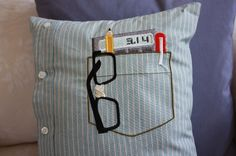 Nerd Pocket Pillow: All the classic nerd accoutrements in one cute pilow. The embroidered nerd pocket includes thick-rimmed glasses (taped up, of course), pencil, pen, and calculator (with pi at the ready). Made from the shirt of a real New York City businessman!