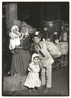 Italian family looking for lost baggage, Ellis Island, 1905.    Photo by Lewis Hine