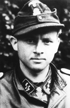 Michael Wittmann (April 22, 1914 – August 8, 1944) was a German Waffen-SS tank commander during the Second World War. Wittmann rose to the rank of SS-Hauptsturmführer (captain) and was a Knight's Cross of the Iron Cross holder. He was a top scoring ace of the war with 168 tank kills.While in command of a single Tiger he destroyed up to 14 tanks and 15 personnel carriers along with 2 anti-tank guns within the space of 15 minutes.
