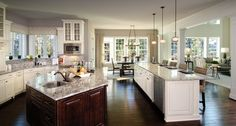 An open kitchen that flows seamlessly into dining and living space reflects the way we live today. The Clifton Park II plan built by Heartland Homes at Walden Pond. Cranberry Township, PA.