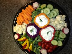 Veggie tray with cabbage and pepper dip bowls
