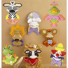 """(Leisure Arts Leaflet #1218) These whimsical characters are designed to make people smile: each can hold a treat that's revealed when you squeeze their cheeks! These make great little gifts or package trims for kids or the young at heart.Each design is stitched on 7 mesh plastic canvas using worsted weight yarn.Number of Designs: 8 characters that reveal a treat when you squeeze their cheeksApproximate Design Size: Alligator Kiss 3 1/2""""w x 4 1/2""""h; Clown Kiss 3 1/4""""w x 4 5/8""""h; Cow Kiss 3…"""