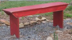 Love the distressed red bench! Maybe a DYI project???