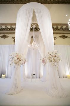 Luxe and glamorous wedding at The Fairmont San Francisco | Floral Design: Soulflower Design Studio  Photographer: Mi Belle Photography  Ceremony - Blush white and ivory palette Orchids, roses and hydrangea on the chuppah