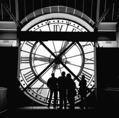 Standing looking out over Paris through the large clock face in the Musee D'Orsay. The museum used to be a railway station in 1939