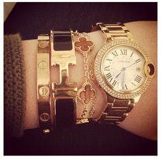 This bracelet/watch stack would definitely hide my awful scar! #Hermes #Cartier