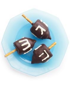 I made it out of... marshmallows. For an easy spin on the Hanukkah top, whip up these fun, kid-friendly treats. Marshmallows form the dreidels' bodies, chocolate kisses serve as the tips, and pretzel sticks act as the knobs. A quick dip in melted chocolate provides a surface for piping white-chocolate Hebrew letters.
