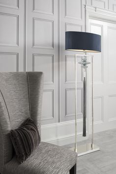 Constance Nickel and Sea Jade Floor Lamp  Bead colours on the decorative tassels may vary from image  A simple yet decorative floor lamp in a nickel finish with blown Opal Jade glass detail and luxurious Sea Jade tassel by Wendy Cushing. Finished with a oval lamp shade in Dark Teal Satin