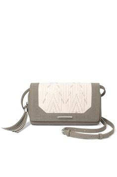 An adjustable strap transforms this everyday wallet into a medium-sized crossbody bag. The Nolita Medium Crossbody bag in Winter White is a must have accessory.