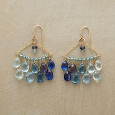 "Rendezvous Earrings Item No. 45138	 $380.00 Thoi Vo  arranges aquamarine, blue topaz, iolite, kyanite and apatite rendezvous in stunning chandeliers that make the most of the blue spectrum. 14kt goldfilled links and French wires. Handmade in USA. 2""L.  www.sundancejewelry.com"