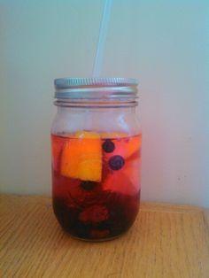 Detox water, lemon, raspberries, blueberries, and blackberry's.