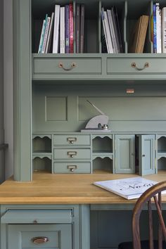 A handmade writing desk. The worktop is full stave oak finished. The desk is finished with high levels of detailing on both the frames and drawers. All of the brass handles and pulls are antique. There is a generous amount of storage built in to the desk, including drawers and a bookshelf.   T.  0207 935 2255 E. design@charliekingham.co.uk