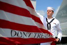 Don't Tread On Me - A sailor hoists the #USNavy jack.