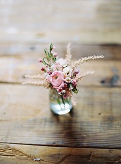 Pretty flowers in a mason jar. A simple little centerpiece.