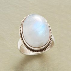 GAZING AT THE MOON--A rare and lovely sight—moonstone rises above sterling silver in a ring that romances with an inner glow. Exclusive. Whole sizes 5 to 9.